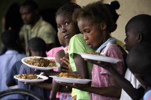 families receiving aid and food in Haiti
